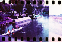 Walthamstow Marshes - Lomochrome Purple - Rowers (Michael Goldrei (microsketch)) Tags: park bridge color film nature water sport forest 35mm boats boat canal lomo lomography purple hole reserve row holes negative diana chrome f valley lea dianaf barge xr walthamstow sprocket rowers sprockets marshes barges 100400 walthamstowe lomochrome