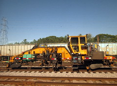 Nordico Rail Equipment In Portage, WI. (dccradio) Tags: railroad trees sky tree tower wisconsin train track rail bluesky powerlines amtrak rails greenery canadianpacific cp portage utilitypole powerpole railyard wi electriclines railfans nordico railequipment
