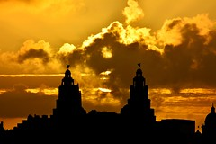 No Smoke without Fire (3peaker (alun.disley@ntlworld.com)) Tags: uk sky weather silhouette architecture clouds liverpool sunrise buildings cityscape shadows waterfront sunbeams merseyside liverbuilding nikond7100 3peaker vision:sunset=0782 vision:clouds=0525 vision:sky=0894