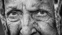 Into her life (Giulio Magnifico) Tags: life woman look closeup eyes deep streetphotography streetportrait soul elder udine nikond800e nikkormicro105mmafsvrf28