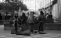 the winter holidays #12 (Joo Carmo) Tags: christmas street family winter people blackandwhite bw musician music woman playing man cold color film home portugal shop musicians contrast analog self vintage shopping photography holidays artist canoneos30 singing dancing grain performance chemistry crossprocessing tradition performers chemicals developed viseu c41 canonef85mmf18 nonstandard cossprocess