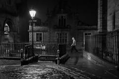 Move along now (Lucky Poet) Tags: light wet rain night walking scotland blackwhite edinburgh streetlamp cobbles oldtown victoriastreet victoriaterrace westbow