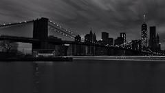 Night Trippin' (adrianmojica) Tags: nyc blackandwhite bw newyork monochrome skyline noir brooklynbridge slowshutter