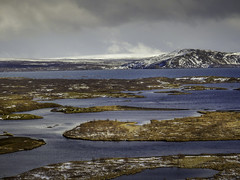 Islands (Daniel C P M) Tags: blue orange mountain lake snow water clouds river landscape island islands landscapes iceland europe tide olympus scandinavia liquid thingvellir