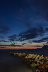 Off Shore (mijkat) Tags: longexposure blue sunset orange water yellow clouds canon rocks jetty iii perspective smooth 1855 efs wgf weldingglass 550d 150sec weldingglassfilter