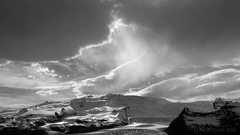 when the sun falls madly in love with a glacier (lunaryuna (off to Iceland for 2 weeks)) Tags: light sky bw mountain monochrome sunshine blackwhite iceland spring lunaryuna cloudscape vatnajokull southiceland ethereallight lightmood seasonalwonders