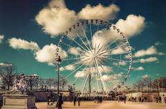 Paris,Tuilleries (Luc Mercelis) Tags: city blue red people paris green yellow clouds tuileries citytrip cityoflight minoltaprimelens sonyslt77v minoltaprimelens50mm minoltaprimelens24mm