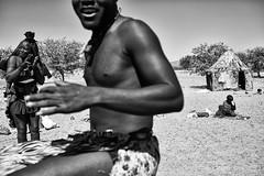 Himba Dances 1 (alisdair jones) Tags: africa woman man children dance dancing hut tribe namibia himba ef35mmf14lusm
