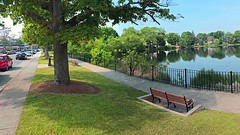 Main Street, Almost Summer (AntyDiluvian) Tags: park boston bench spring pond mainstreet massachusetts may melrose shade ellpond