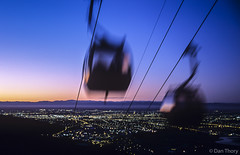 Gondolas (Dan Thory) Tags: city newzealand urban motion blur mountains color colour speed outdoors evening colorful cityscape sundown outdoor dusk blurred colourful warmlight southislandcablecarcarscablecarcablecarsaerialviewcity southislandcablecarcarscablecarcablecarsaerialviewcitystock