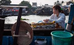 waiting for breakfast (grapfapan) Tags: street morning travel woman river boat vietnam mekongdelta mekong