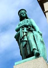 A woman's wiles (Nathalie_Dsire) Tags: summer statue spring arms stuttgart bluesky sword schlossplatz