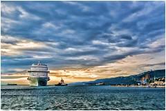 ciao a tutti (Giorgio Serodine) Tags: canon tramonto mare cielo colori molo trieste golfo friuli orizzonte nubi digiorno navedacrociera elaborata rimorchiuatori