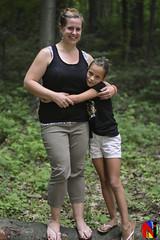 NIP_1318 (Never Infamous) Tags: family girls portrait love girl forest evening log woods hug pennsylvania daughter mother overcast pa balance embrace wooded centralpa lebanonpa rexmont neverinfamous pavlesich