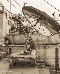 Waiting (upayankita) Tags: travel india man monochrome umbrella river streetphotography holy varanasi wait ganges uttarpradesh d3200