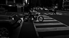 Follow on. (Neil. Moralee) Tags: road street blackandwhite bw white black monochrome car leather bike angel night dark lumix mono drive crossing ride darkness traffic jeep boots helmet hell neil harley panasonic pedestrians motorcycle biker headlight davidson rider lx7 moralee