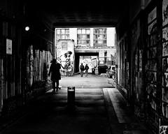 World in Transit (floressas.desesseintes) Tags: door berlin graffiti courtyard tor hof prenzlauerberg schwarzweis streetfotografie