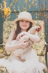 Anna and Lillian (Kilkennycat) Tags: portrait pet white chicken hat animal canon children sitting child dress 50mm14 hen seated backyardchicken 500d pullet kilkennycat t1i ryanconners