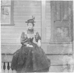 Woman in dark dress sitting on a porch (Meyersdale Public Library) Tags: people women hats 1900s 1890s 1880s porches photobox12 cookalbum