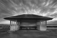 Shelter [explored 16th june 2013] (Nigel grieves) Tags: longexposure sea blackandwhite bw seascape clouds canon mono explore shelter canon1022mm explored canon60d lee10stop nigel176