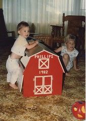 Eliot, Lane, and the new toy box, 1982 (RobotSkirts) Tags: yellow barn carpet 1982 toddler livingroom lane eliot toybox tbt eliotphillips toybarn lanephillips