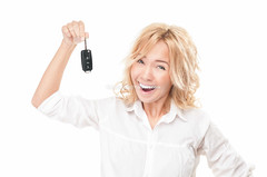 Happy young woman with car key on white. (Konstantin Yolshin) Tags: auto show new people woman white cute girl beautiful smile face car lady female mouth happy person one drive key pretty hand open expression background object transport joy young happiness excited delight license laugh blonde surprise winner present shock driver positive win cheerful joyful success purchase isolated hold owner caucasian