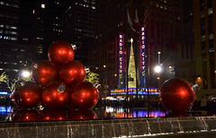 Holidays on Sixth Avenue (afagen) Tags: christmas nyc newyorkcity red sculpture favorite newyork night marquee manhattan rockefellercenter ornament gothamist radiocitymusichall radiocity exxonbuilding 1251avenueoftheamericas
