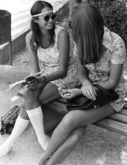 Out of Oz (fillzees) Tags: bw woman girl bench person book candid skirt tourist greece crete grin aussie miniskirt