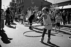 Hula Hoop! (Fin Azvandi) Tags: street shadow bw game wisconsin children olympus madison hulahoop ep3 willystreetfair madison365 panasoniclumix14mmf25