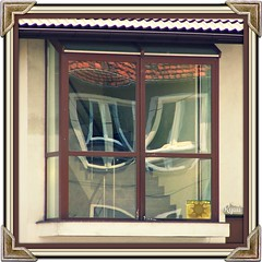 # windows (Ryuu) Tags: city windows roof light shadow red urban brown sun white house distortion building art window glass yellow wall sepia architecture stairs composition reflections outside reflecting mirror wooden sill artistic angles sash tiles squareformat frame inside walls framing effect reflexion corners browny