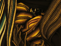 scarfs in my bedroom, 2013-12-25, 01-49-34 (tributory) Tags: blue winter orange brown abstract color colour green texture lines yellow scarf grey clothing knitting purple patterns curves textile present mauve scarves woven knitted cloth weaving scarfs appereil