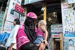 H504_3218 (bandashing) Tags: street england woman baby black shopping manchester child mother hijab covered shops niqab sylhet bangladesh carry socialdocumentary burkah aoa bondor bandashing akhtarowaisahmed bondorpoint