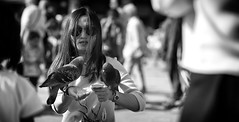 The Pigeon Whisperer (Just Ard) Tags: street venice people blackandwhite bw woman blancoynegro monochrome sunglasses person photography mono nikon feeding noiretblanc zwartwit pigeon candid 85mm shades d750 unposed  biancoenero schwarzundweis justard