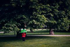 Why it doesn't rain, dad? (Toni Ahvenainen) Tags: park trees zeiss umbrella kid child frog aura ourdoors wideopen batis1885