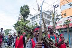H504_3409 (bandashing) Tags: street trees red england people green manchester watch crowd logs sylhet bangladesh carry mentalhealth socialdocumentary aoa shahjalal bandashing akhtarowaisahmed treecuttingfestival lallalshahjalal