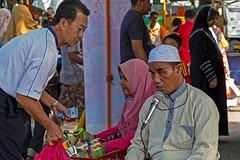 Giving is ibadah (zolmuhd) Tags: man tipping shahalam basking blindman pasartani