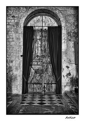 Old church door (Artico7) Tags: door wood blackandwhite bw italy church monochrome beautiful saint stone blackwhite iron arch fuji floor squares steel entrance andreas dome sacred curtains historical locks exit biancoenero friuli udine hinges venzone sanandrea xe1 saintandreas sandreas