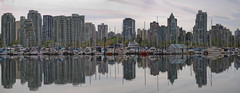 Reflection at Vancouver BC Waterfront Marina (JPLPhotographyPDX) Tags: city sea panorama canada reflection public skyline vancouver creek marina buildings boats harbor living community downtown bc waterfront view scenic parks columbia seawall highrise british recreation yachts coal condominium false