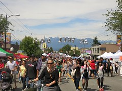 'Ar Free Day (Ruth and Dave) Tags: road street people mountains festival vancouver balloons mainstreet cyclist stroller crowd mountpleasant cottoncandy candyfloss pushing carfreeday