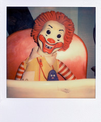 Killer Clown (Brock5604) Tags: old portrait slr film strange shop vintage ronald polaroid sx70 weird store scary stuffed doll antique clown tag evil indoor retro creepy spooky thrift day1 land instant grimace mean highchair pricetag mcdonald impossible px70
