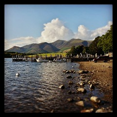 Down by #Derwentwater in the #lakedistrict in #Cumbria.  #sunshine (Paul Simpson Photography) Tags: uk england lake holiday water sunshine square boats rocks lakedistrict hills cumbria squareformat views derwentwater viewpoint mountians tiltshift scenicview ruralscene photoof july2013 paulsimpsonphotography instagram instagramapp uploaded:by=instagram photosofboats samsunggalaxys3 placestoseeincumbria placestoseeinthelakedistrict thingstodoincumbria thingstodointhelakedistrict