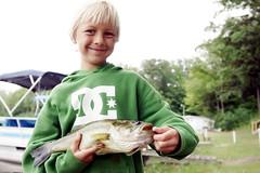 Proud of his catch (randyr photography) Tags: big bass sony alpha largemouth sal1635z slta77v smilingboyholdingbigbass