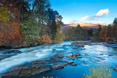 Flowing through the Colours (PeterYoung1.) Tags: uk autumn trees mountains nature water beautiful landscape scotland rocks colours scenic falls atmospheric fallsofdochart killin
