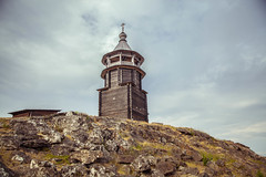 lonely belfry (Olga Kruglova) Tags: old sea summer white church nature water festival landscape wooden rocks republic village view russia religion north steeple belfry traveling northern scape noize orthodox karelia chupa   varlaam  2013    kareliya  medvezhka keretsky