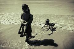 Children of the Sea (AvikBangalee) Tags: shadow red sea tourism beach water sepia kids children fun infant waves child streetphotography lifestyle happiness dailylife bathing playful bangladesh touristattraction decisivemoment seabeach documentaryphotography kuakata patuakhali