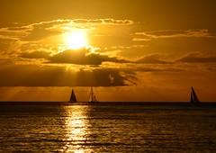 Sail away (Jason Fairbairn Photography) Tags: sunset cloud sun water sunshine clouds boats hawaii boat waves sailing waikiki sail waikikibeach sunray waikikisunset
