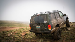 road ranch trees sky mountain grass fog clouds fence lights haze lift jeep mud offroad 4x4 tires dirt trail bumper 1998 kit cherokee wyoming splash plains wheeling laramie cheyenne roofrack xj