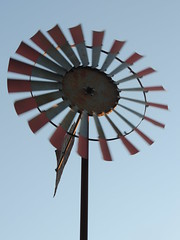 Whirling Windmill at Sunset - HWW!!! (maorlando - God keeps me as I lean on Him!!) Tags: sunset usa reflection windmill metal fan store movement glow texas antique top farm blade vane whirling walkercounty newwaverly hww waterwindmill windactivated happywindmillwednesday windmilltail