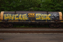 UNCLE SEX (TheGraffitiHunters) Tags: street white black art yellow sex train graffiti colorful paint uncle tracks spray freight benched benching