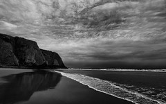 Praia Grande (Canadapt) Tags: bw cliff reflection praia beach portugal clouds grande sand surf waves drama canadapt